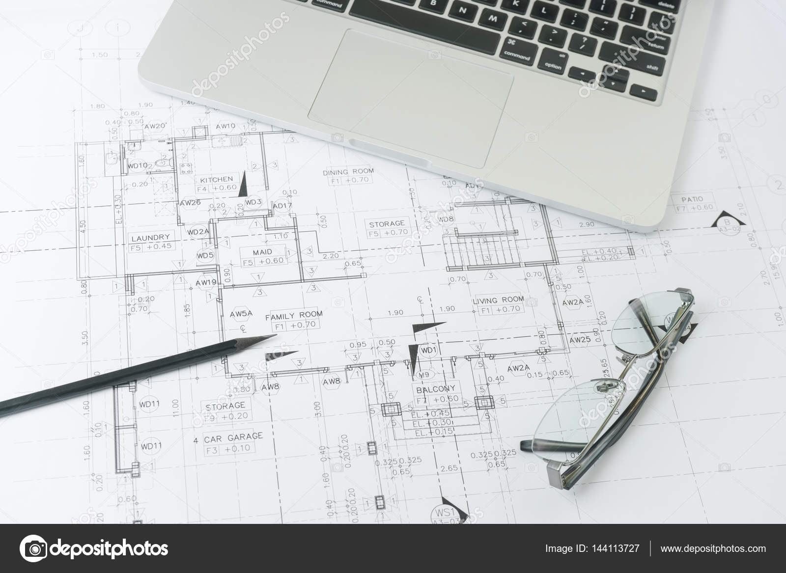 hight resolution of black pencil and computer laptop on architectural drawing paper for construction photo by worldwide stock