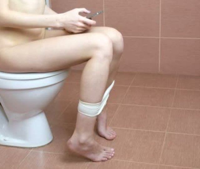 Woman Sitting On Toilet In The Bathroom Using Smartphone A Body Without Clothes Stock Footage