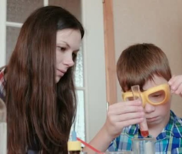 Chemistry Experiments At Home Mom And Son Make A Chemical Reaction With The Release Of