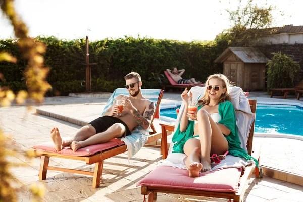 Four Young Women Sunbathing Bikinis Sun Chairs Swimming