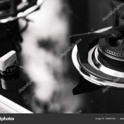 Kitchen Knobs Patio 特写镜头清洁新厨房燃气灶炉旋钮热卷开关优雅金属钢黑色和白色 图库照片 特写镜头清洁新厨房燃气灶炉旋钮热卷开关优雅金属钢黑色