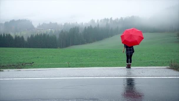 alone woman under umbrella