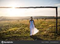 Young Romantic Woman Meadow Sunset. Girl In