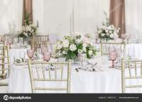 Beautiful table setting with crockery and flowers for a ...