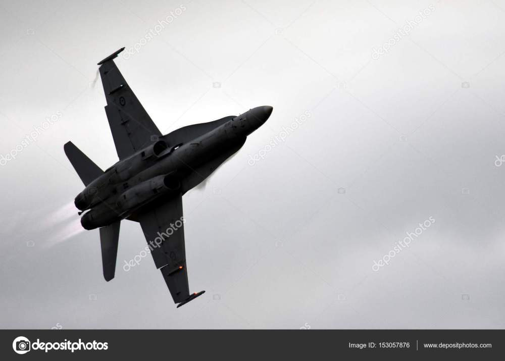 medium resolution of silhouette of f18 hornet fighter aircraft in flight stock photo