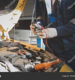 mechanic works with voltmeter car electrics electrical wiring stock photo [ 1600 x 1000 Pixel ]