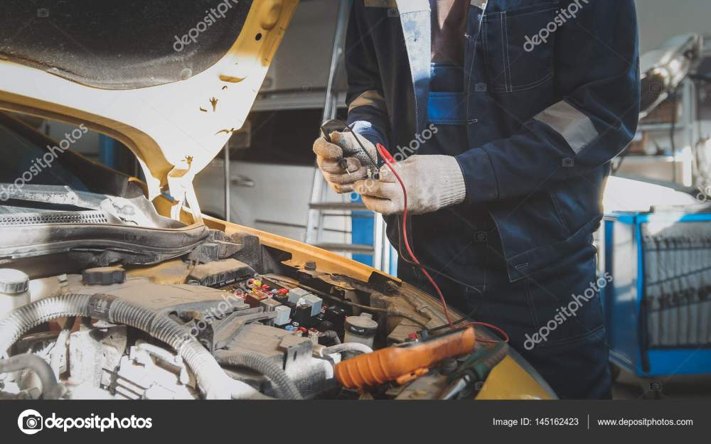 medium resolution of mechanic works with voltmeter car electrics electrical wiring stock photo
