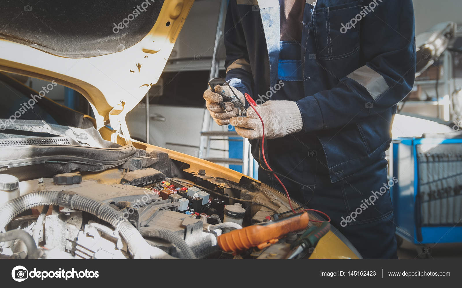 hight resolution of mechanic works with voltmeter car electrics electrical wiring stock photo