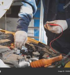 mechanic works car electrics with voltmeter electrical wiring stock photo [ 1600 x 1000 Pixel ]