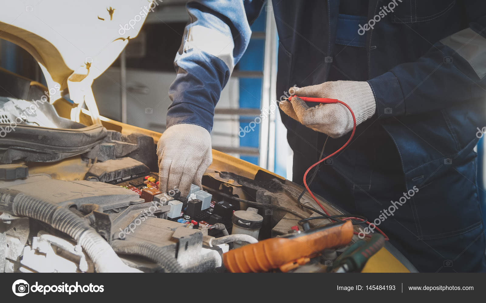 hight resolution of mechanic works car electrics with voltmeter electrical wiring stock photo