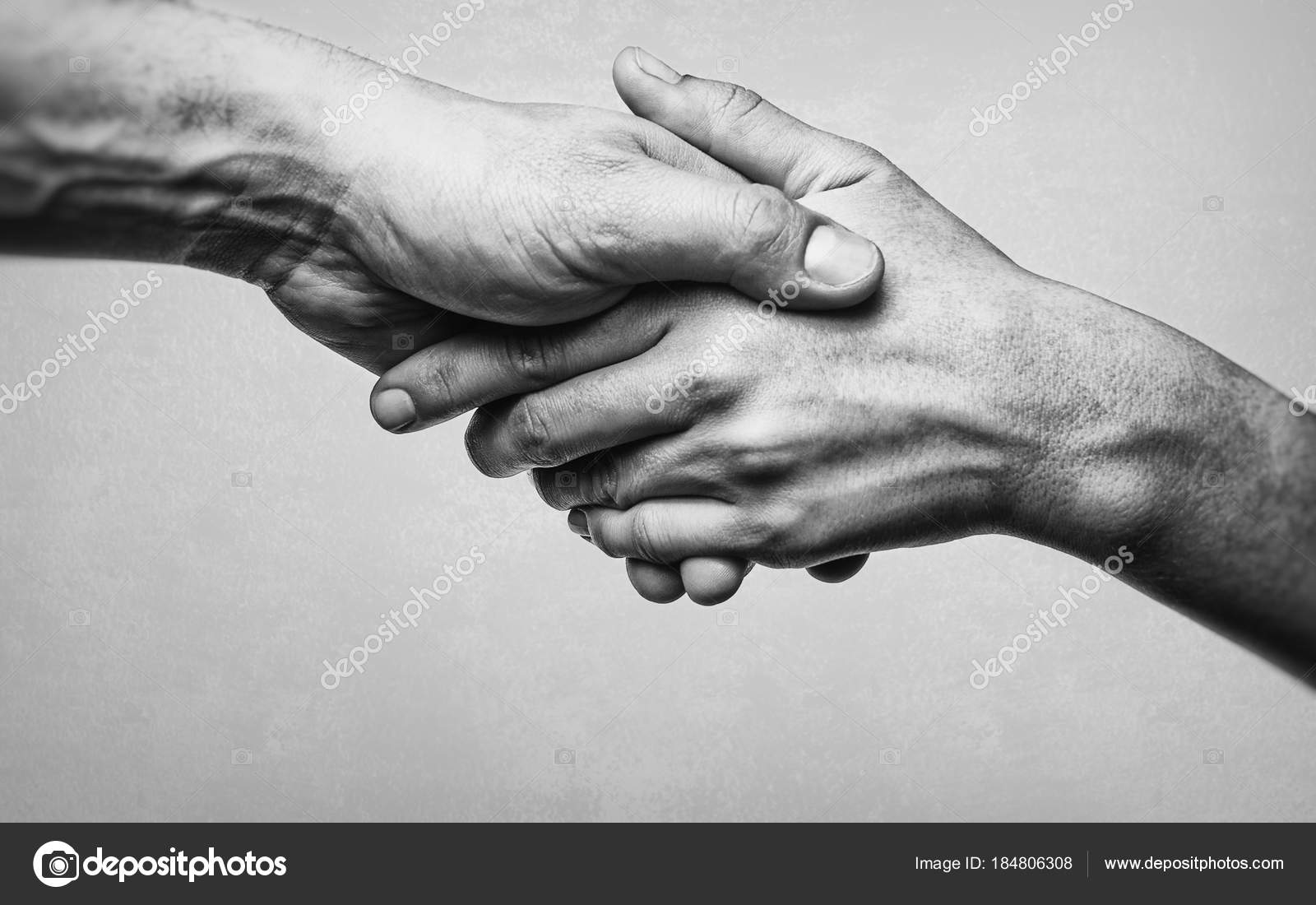 https depositphotos com 184806308 stock photo firm handshake two partners black html