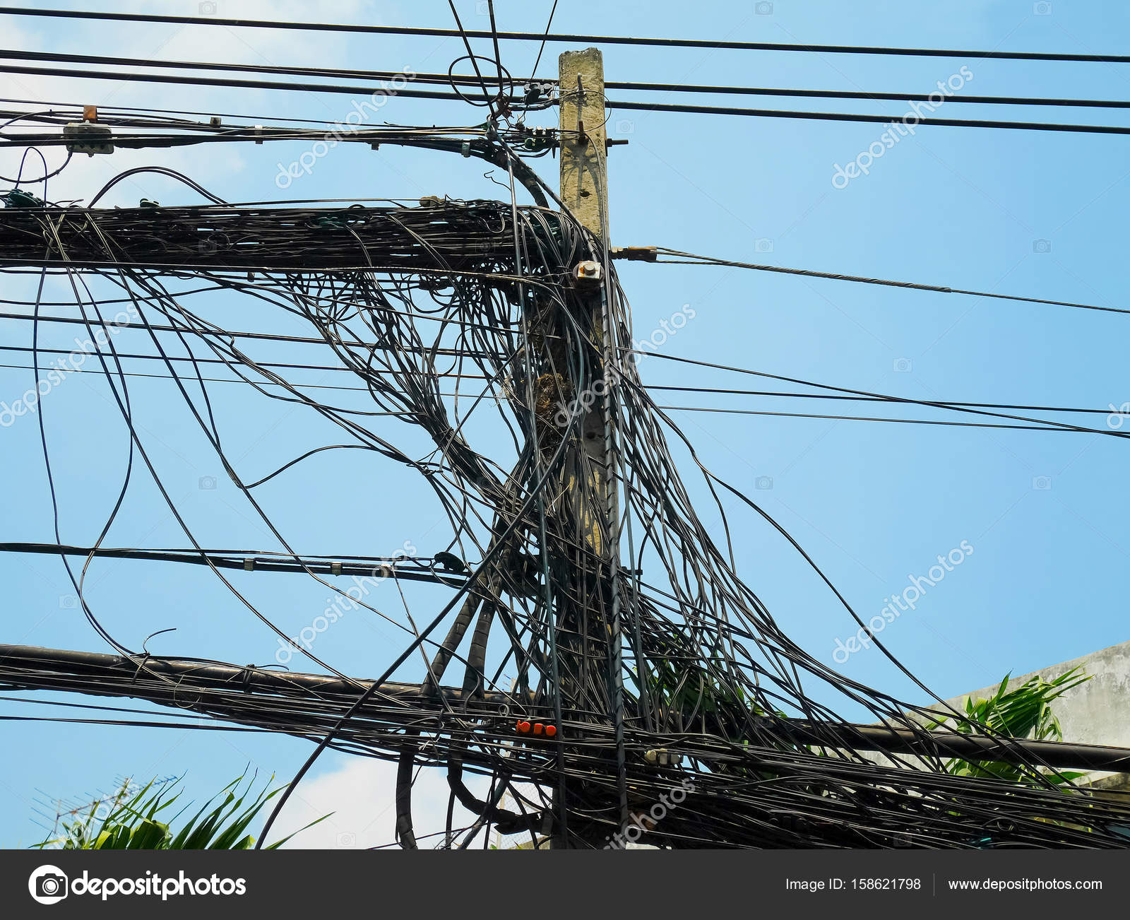 hight resolution of utility pole supporting messy wires stock photo