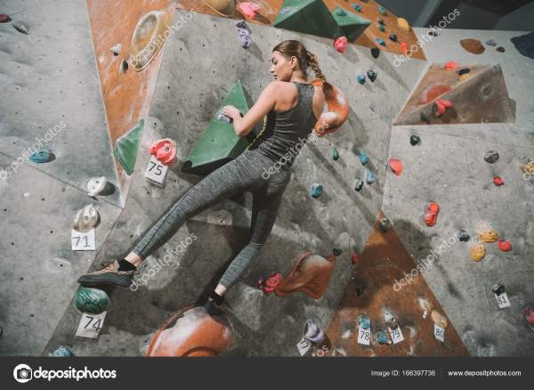 Woman Climbing Wall With Grips Stock Arturverkhovetskiy #166397736