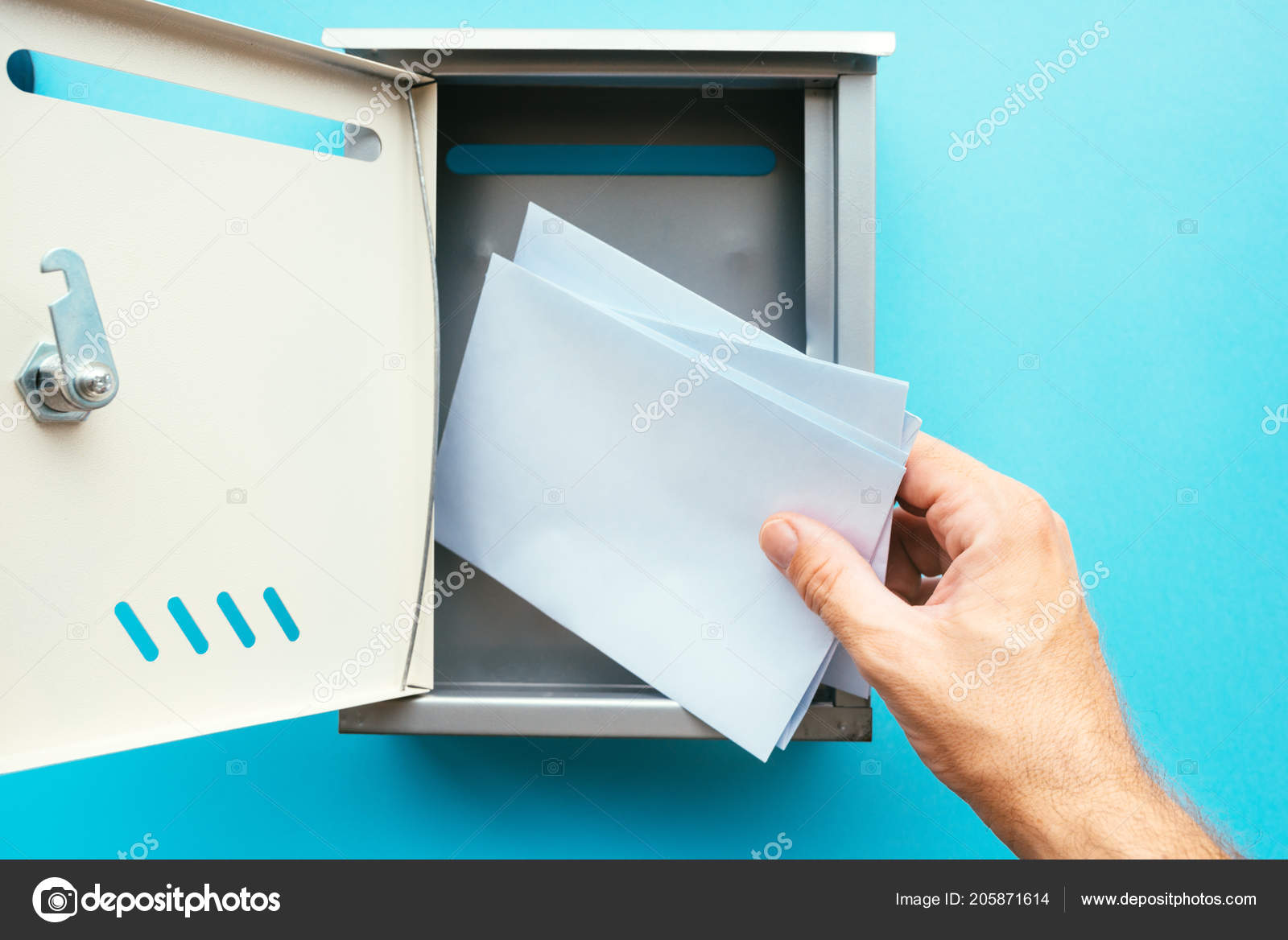 hand inserting letter envelope