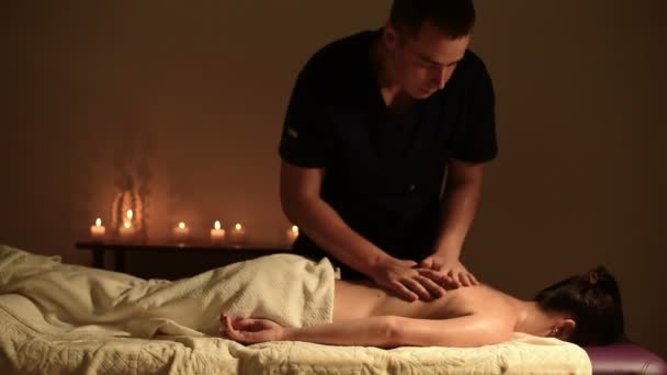 Medium Shot A Big Guy A Masseur Does A Massage To A Young Girl Lying On