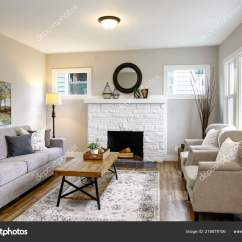 Traditional Armchairs For Living Room Grey Floor Spacious Fireplace Sofa Facing Two Stock Photo