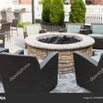 Images Fire Pits With Seating Hotels Patio Set Fire Pit Chairs Tables Umbrelllas Barbeque Grill Stock Photo C Woodysphotos 207086604