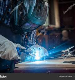 strong man welder work clothes hard working welds welding machine stock photo [ 1600 x 1167 Pixel ]