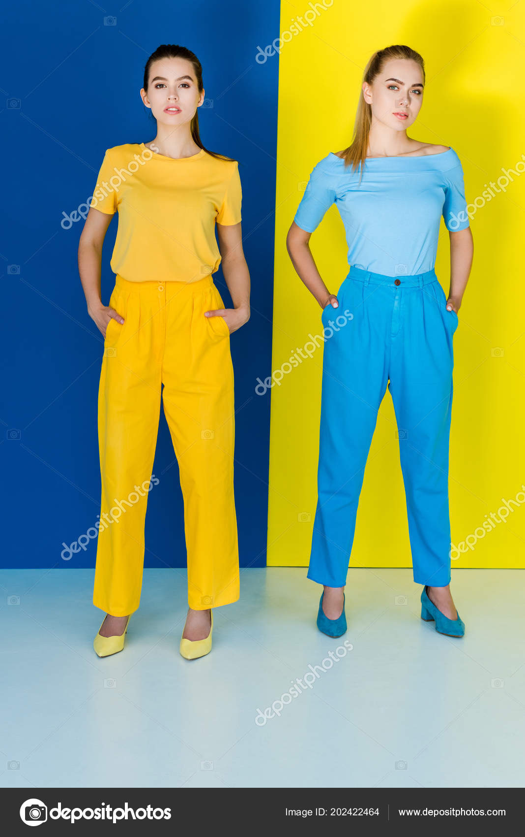 Blue And Yellow Outfit : yellow, outfit, Attractive, Young, Girls, Yellow, Outfits, Posing, Background, Stock, Photo, IgorVetushko, #202422464