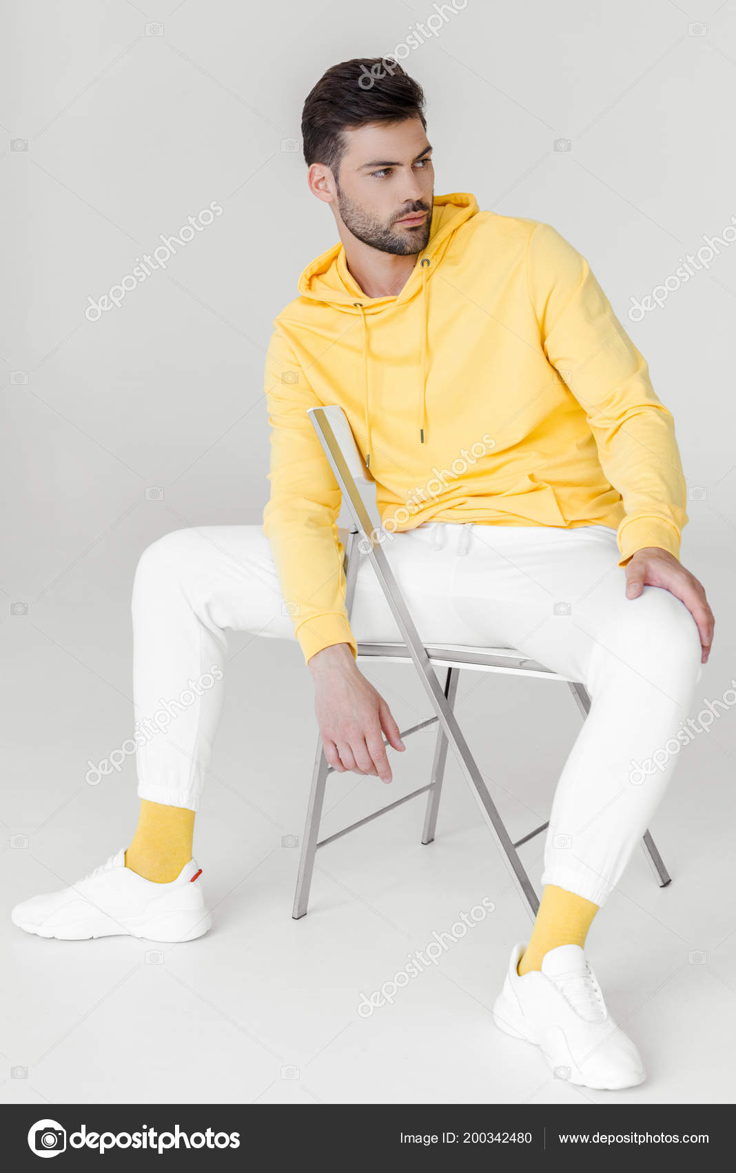 Chair Pants Stylish Young Man Yellow Hoodie White Pants Sitting Chair Looking