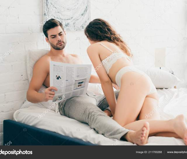 Sexy Girl Lingerie Touching Boyfriend Reading Newspaper Bed Stock Photo