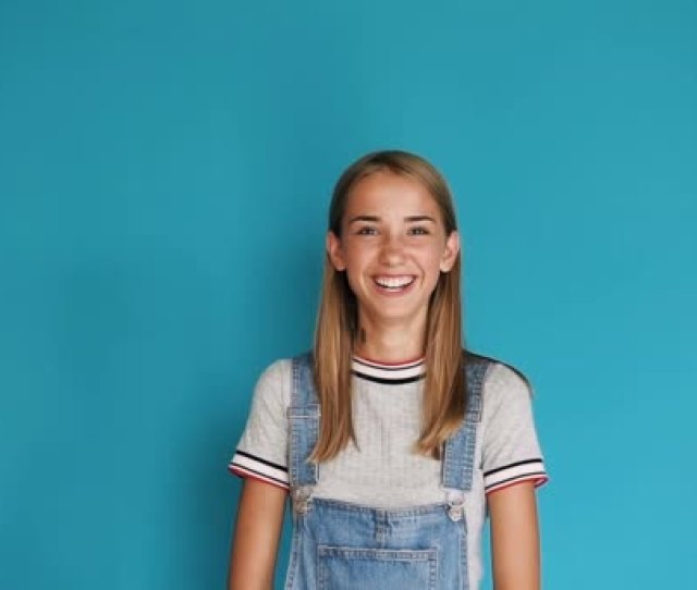 Portrait Of Cute Teen Girl With Long Hair Smiling At The Camera On Blue Background Close Up Portrait Of Attractive Girl Smiling Confident And Pretty
