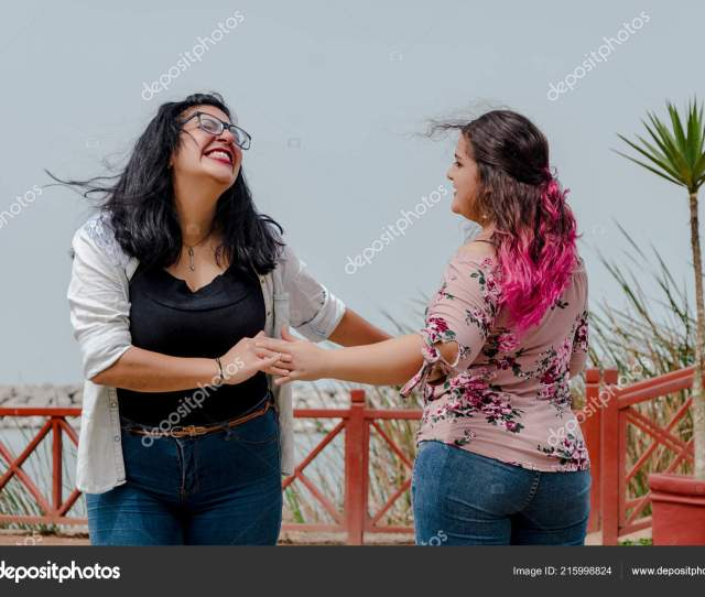 Two Chubby Girls With Inline Skates In The Park Stock Photo
