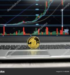 golden titan bitcoin coin on a silver keyboard of laptop and diagram chart graph on a  [ 1600 x 1103 Pixel ]