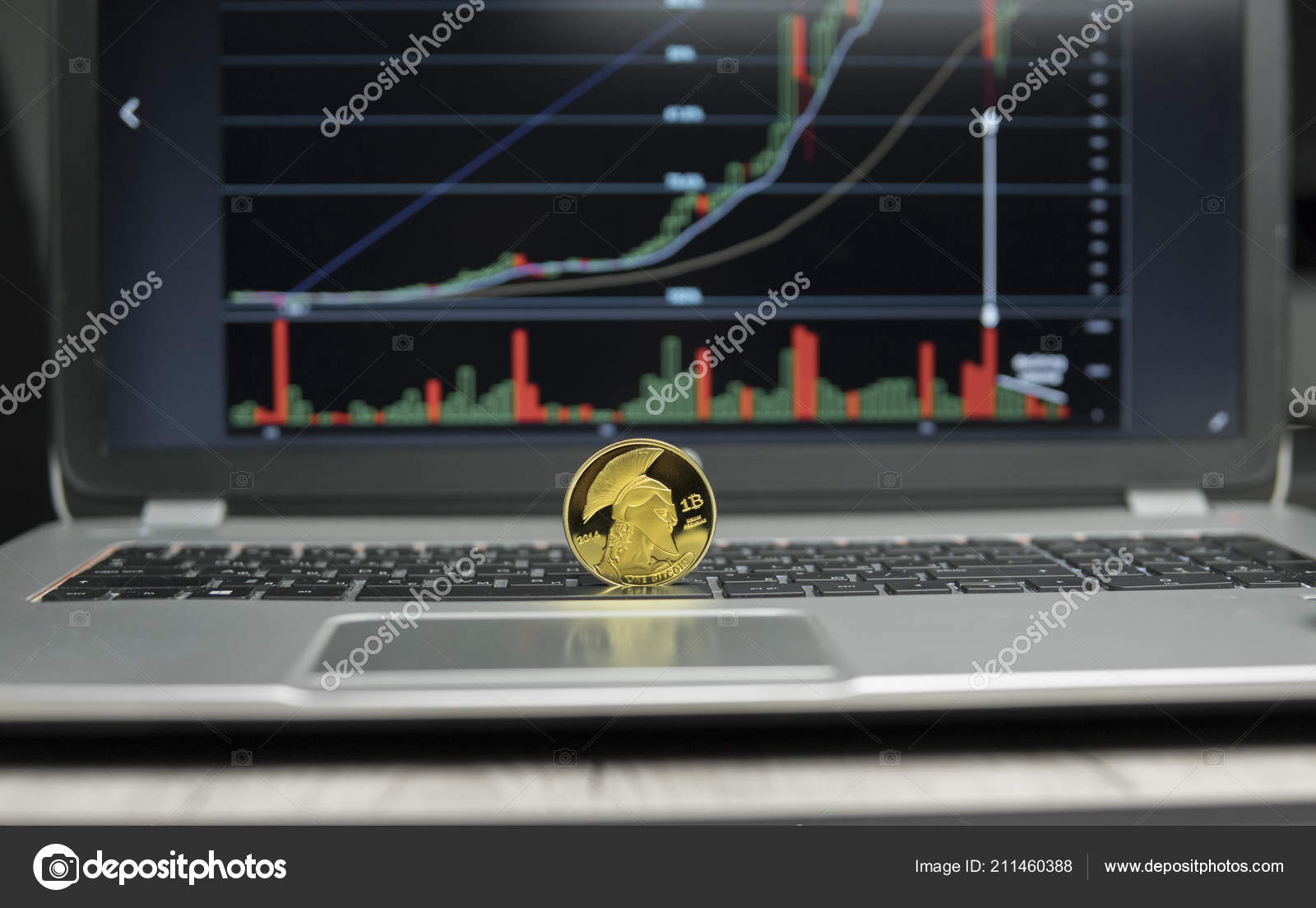 hight resolution of golden titan bitcoin coin on a silver keyboard of laptop and diagram chart graph on a