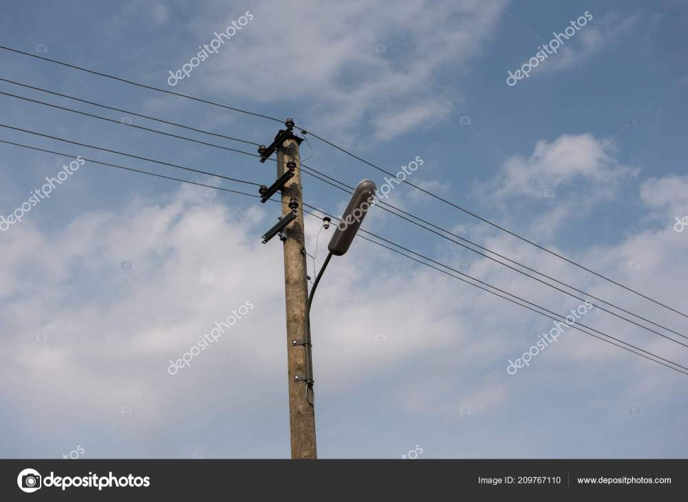 medium resolution of wooden street lamp post electric wires blue sky white clouds stock photo