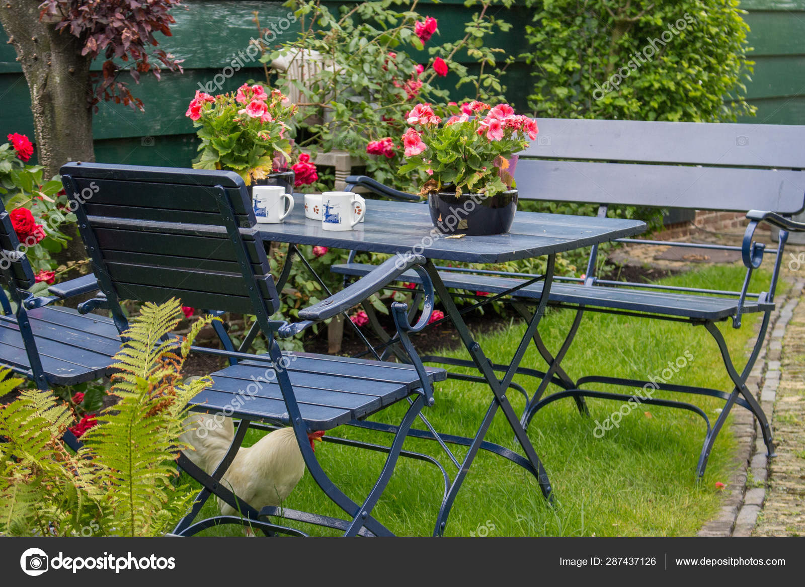 cozy summer backyard outdoor table chairs patio tea table white stock photo image by c happypilgrim 287437126