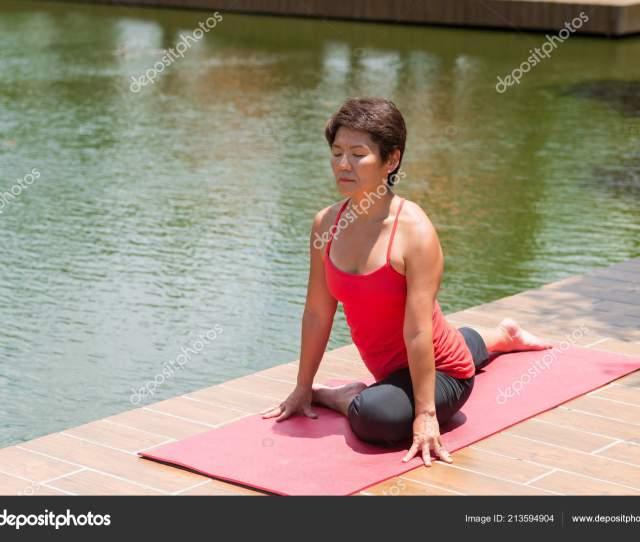 Japanese Mature Woman Sitting Pidgeon Position Pond Park Stock Photo