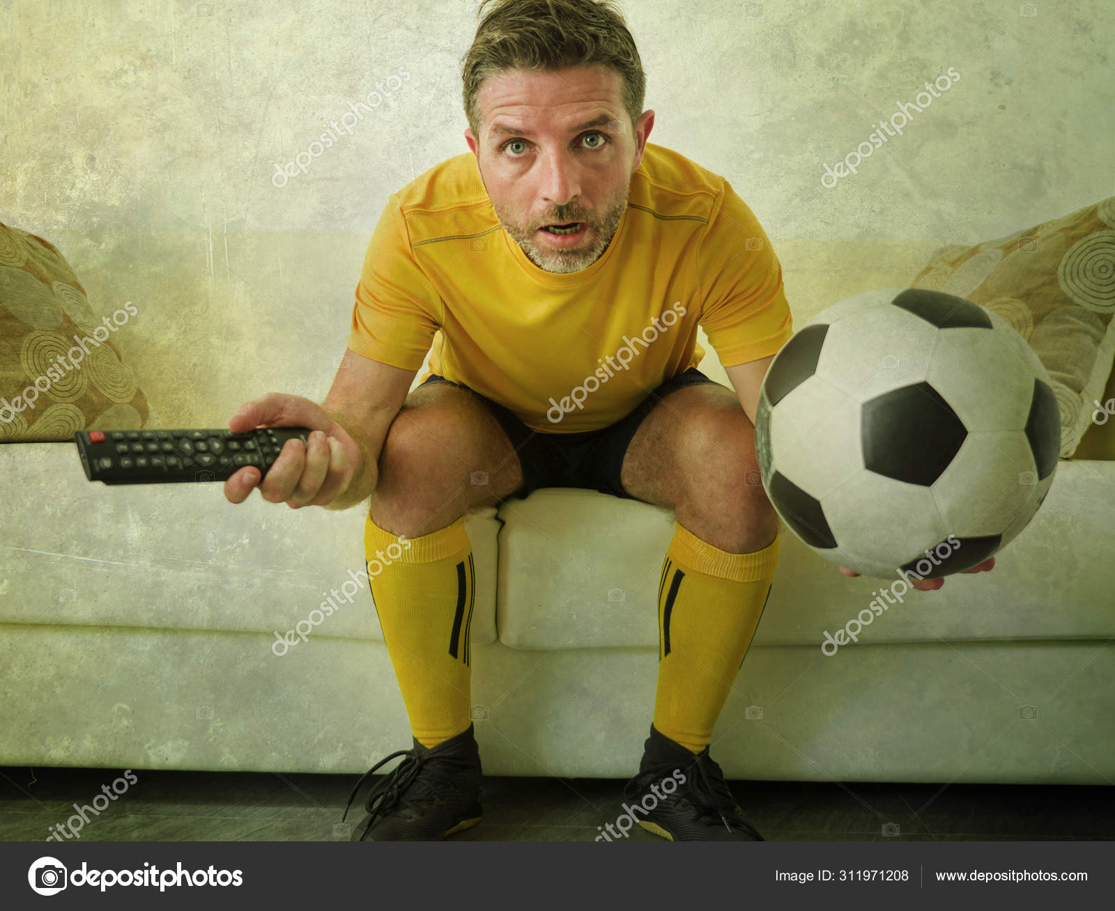 Which one of them do you think you would be? Funny Portrait Of Young Stressed And Excited Football Fan Man Watching Soccer Game On Tv At Home Couch Dressed In Team Player Uniform Feeling Stress And Emotion Stock Photo By C Thevisualsyouneed 311971208