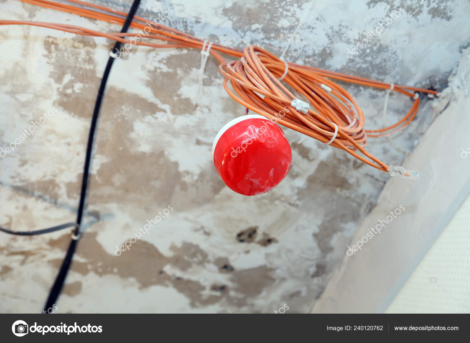 hight resolution of closeup installation and repair of electric cable smoke detector fire alarm system before installing a stretch or suspended ceiling