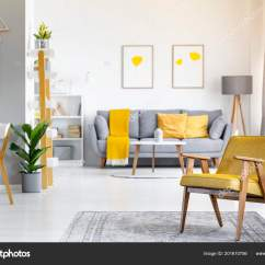 Yellow And Grey Chair Blu Dot Armchair Rug Plant Open Space Interior Posters Couch Stock Photo