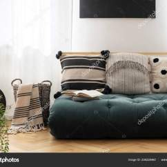 Green Cushions Living Room White Display Units For Patterned Futon Bright Interior Blanket Basket Stock Photo
