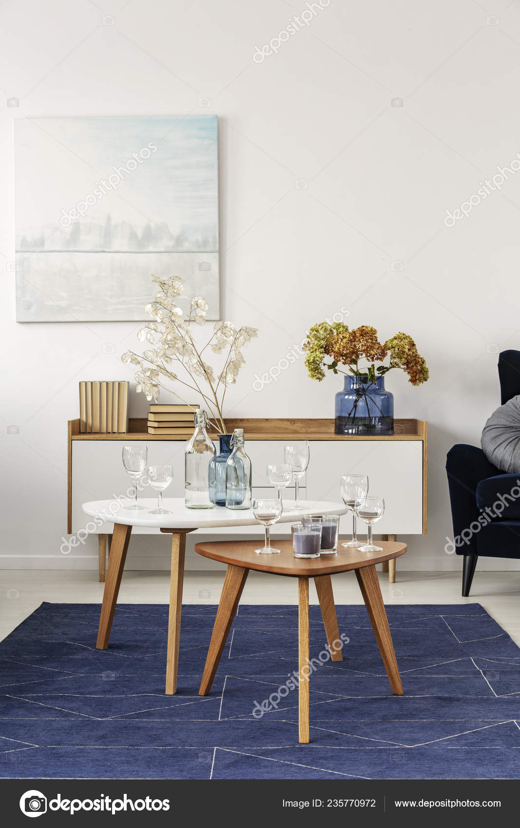 two coffee tables wine glasses candles middle bright living room stock photo image by c photographee eu 235770972