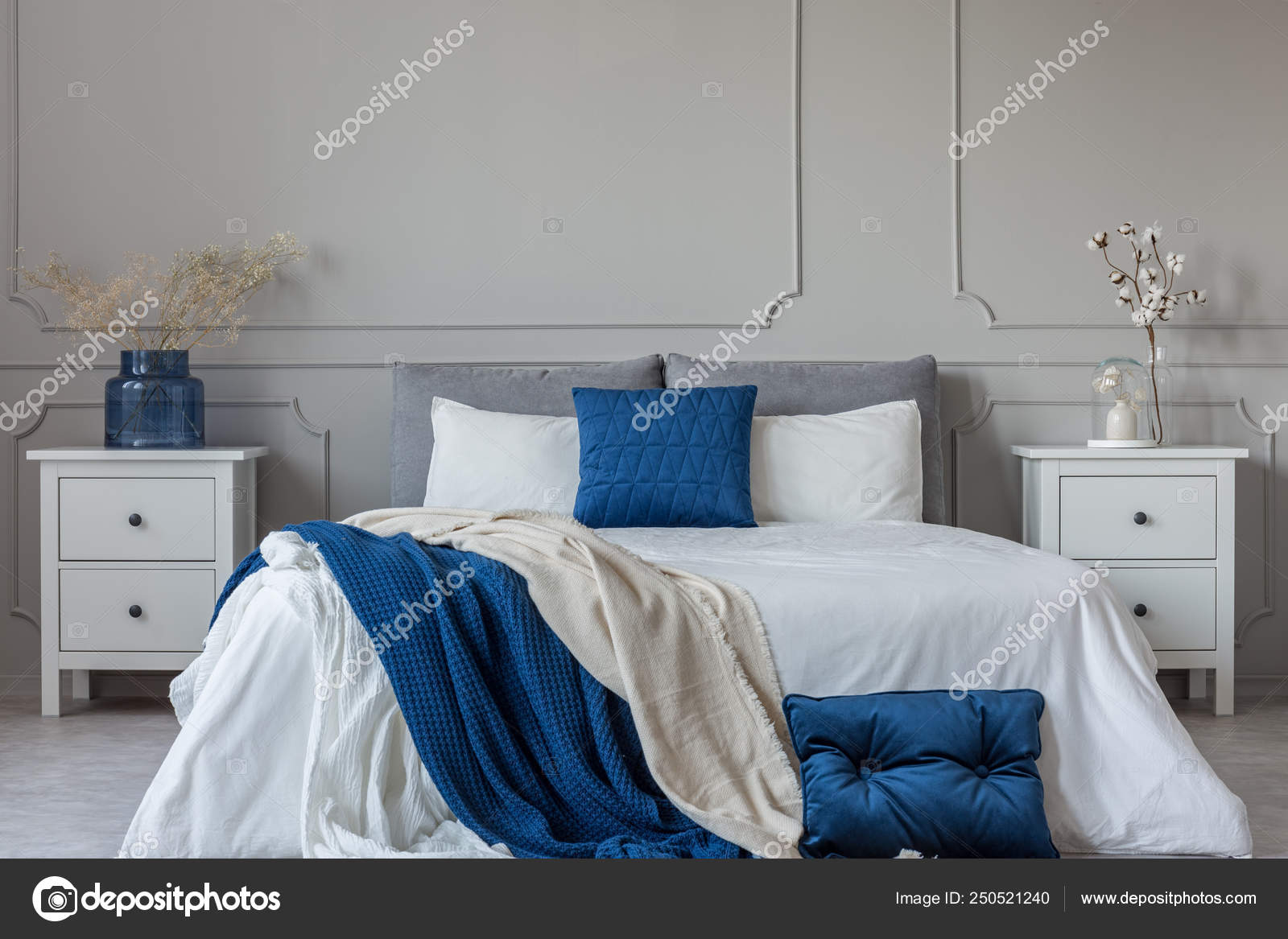 King Size Bed With Grey Blue And White Bedding Between Two