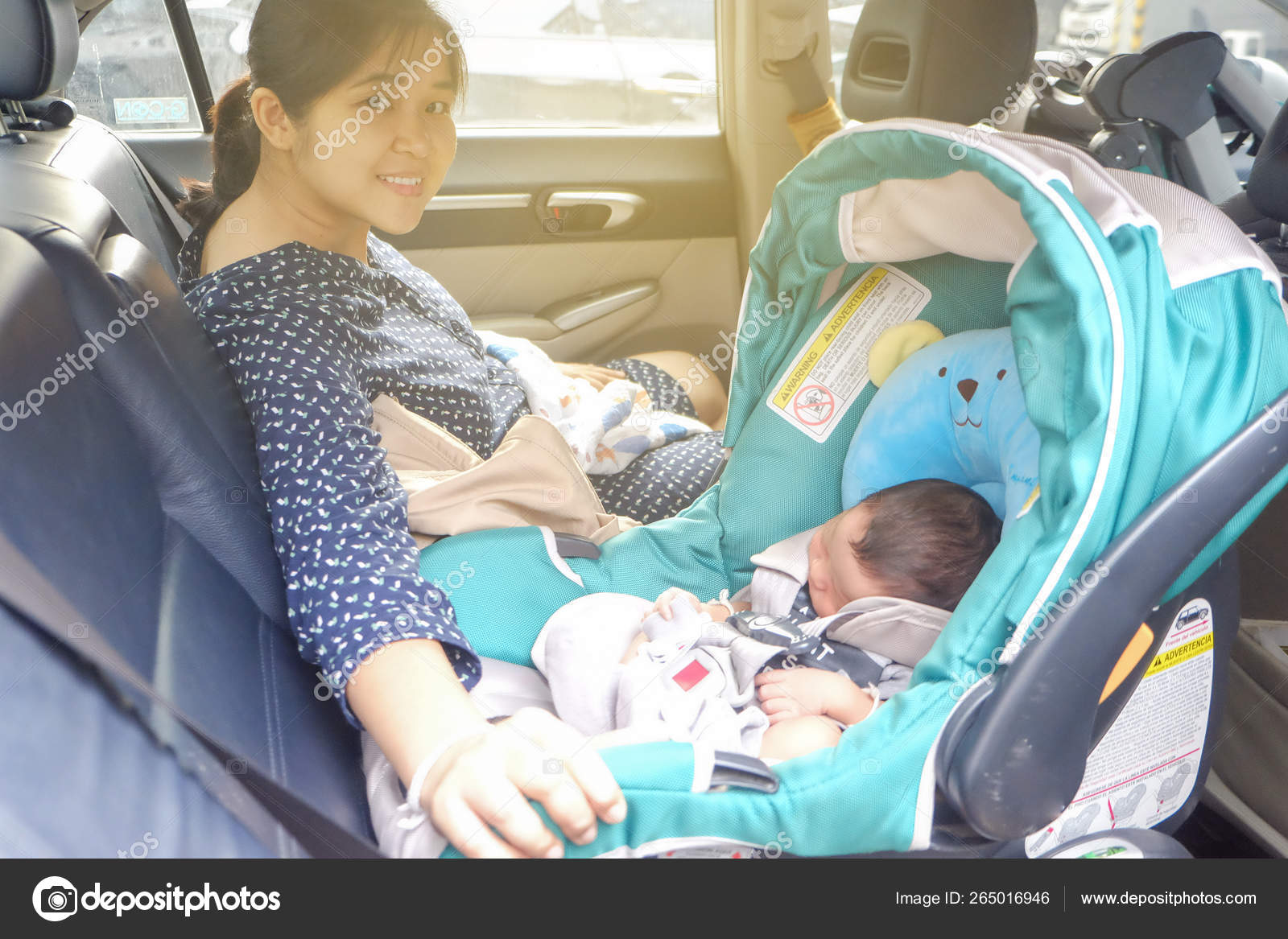 Mom With Infant Child Boy Inside Savfty Car Seat Stock Photo C Benedixs 265016946