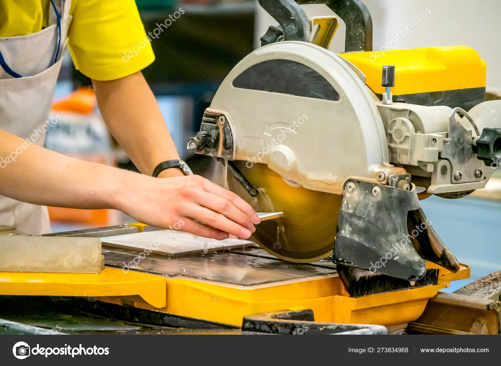 cutting tile a circular saw a builder performs a tile cut finishing work circular saw with water supply work at the machine stock photo image by c grinphoto 273834968