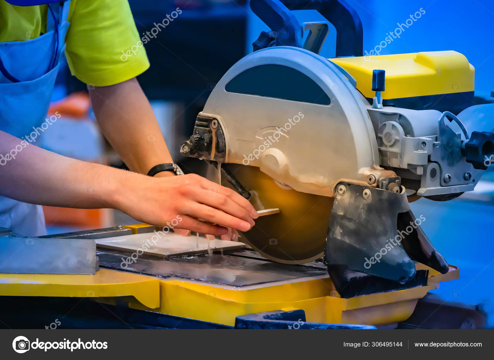 work sawing tile work on a circular saw cutting stone and tiles stone processing equipment workshop with circular saw stock photo image by c grinphoto 306495144