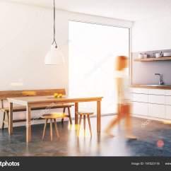 Kitchen Corner Sinks Outdoor Grill 女人走在白色的饭厅和厨房角落里阁楼的窗户一个木制的桌子椅子和长凳白色 女人走在白色的饭厅和厨房角落里 阁楼的窗户 一个木制的桌子 椅子和长凳 白色台面和水槽 3d 渲染模拟色调图像双曝光模糊