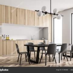 Black Kitchen Tables Cabinets Organizers 现代的白色墙壁厨房角落与全景窗口木地板和工作台面与修造在用具长的黑色 现代的白色墙壁厨房角落与全景窗口 木地板和工作台面与修造在用具 长的黑色桌子 椅子 3d 渲染模拟 照片作者denisismagilov
