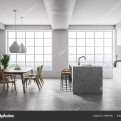 Concrete Kitchen Table Chrome Faucets 现代厨房内部设有白色墙壁混凝土地板白色台面一个小岛一张桌子椅子和两个 现代厨房内部设有白色墙壁 混凝土地板 白色台面 一个小岛 一张桌子 椅子和两个大窗户 3d 渲染 照片作者denisismagilov