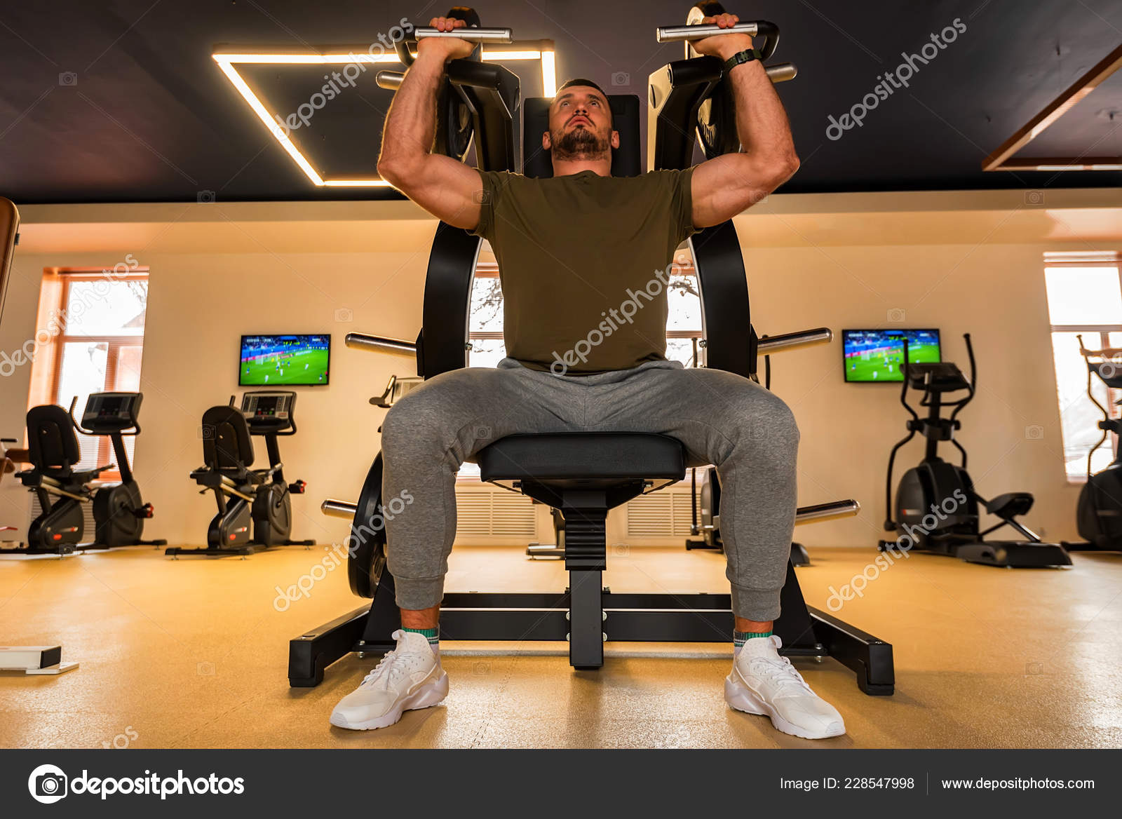 gym chest chair desk chairs for teens young muscular man does lower exercises with machine in modern stock photo