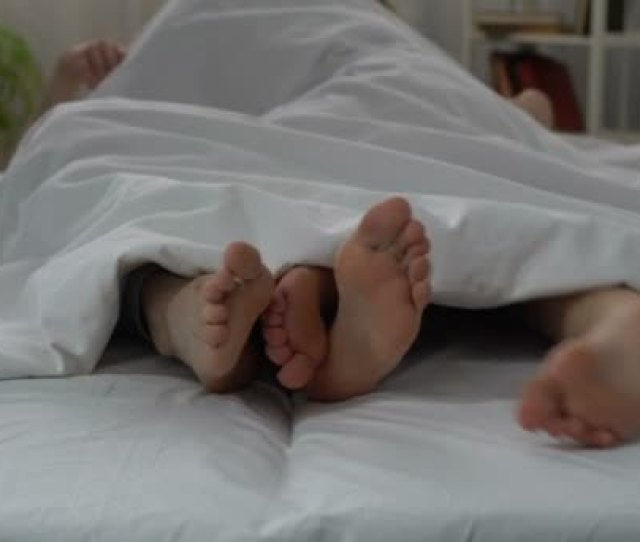 Legs Of Husband And Wife Making Love In Bed Couple Intimate Relations Sex Stock Footage