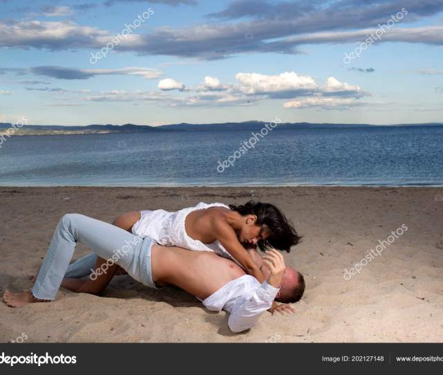 Couple In Love Have Sex Makes Love On Sand Beach Couple Full Of Desire Have Sex On Sand Of Seashore Sensual Lovers Making Love At Seashore Sea On