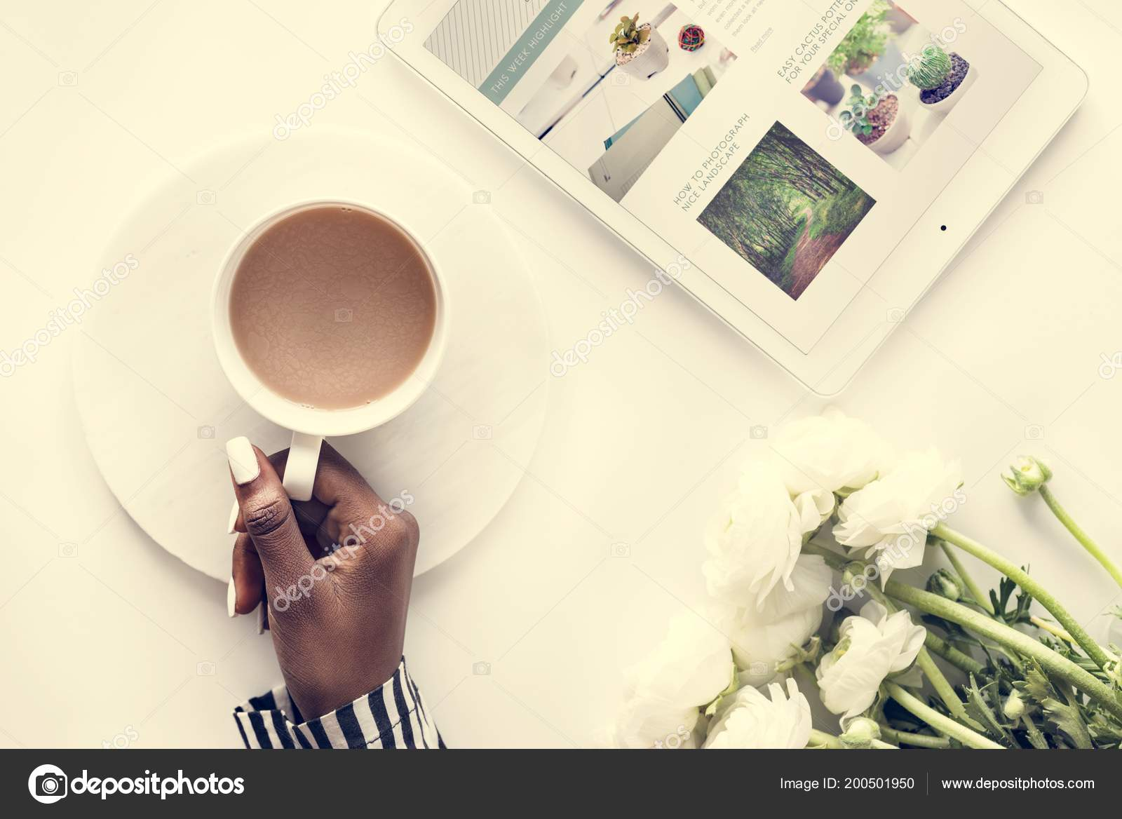 top view person holding cup coffee table digital tablet flowers stock photo image by c rawpixel 200501950