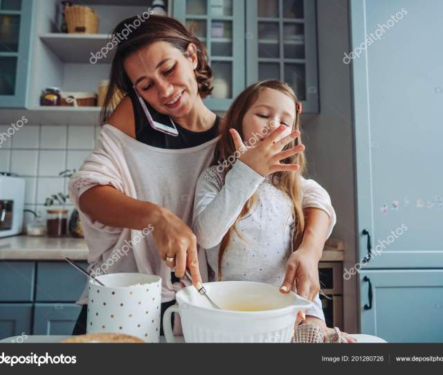 Mom Teaches Her Little Daughter To Cook Food Stock Photo