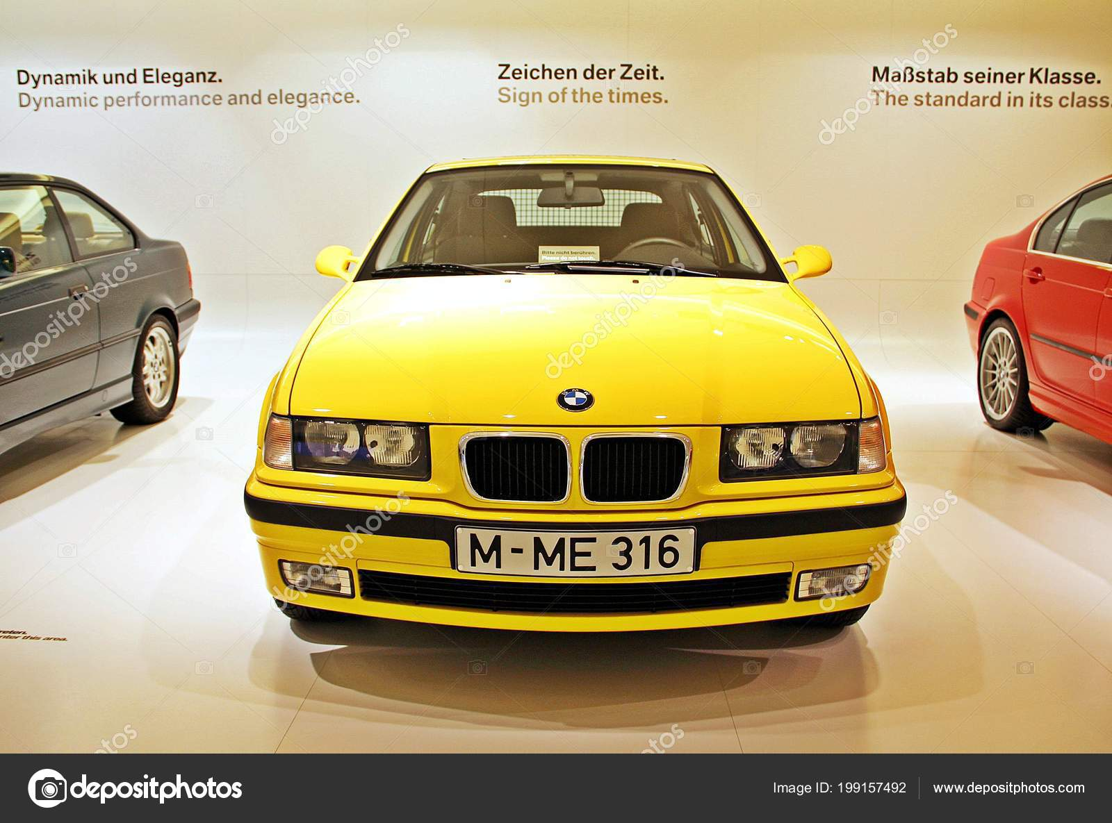 hight resolution of munich germany april 12 2012 display of bright yellow bmw 323i year 2000 at bmw welt in munich germany photo by kpoppie